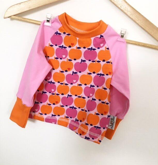 Langarmshirt mit Äpfeln rosa/orange